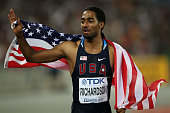 Jason Richardson of United States celebrates with his country's flag after the men's 110 metres hurdles final during day three of the 13th IAAF World...