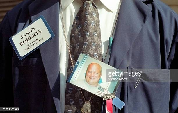 Jason Roberts floor trader at the New York Stock Exchange wearing a photograph of his brother who was killed in the WTC attack