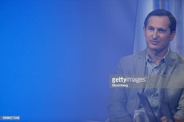 Jason Robins chief executive officer of DraftKings Inc listens during a Bloomberg Television interview in New York US on Tuesday Sept 6 2016 Robins...