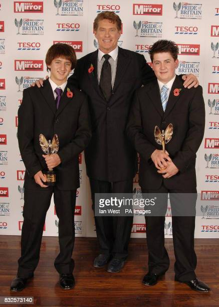 Jason Rodd aged 15 and his brother Daniel Rodd aged 13 from Ipswich receive an Outstanding Bravery Award presented by David Hasselhoff during the...
