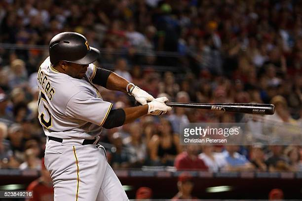 Jason Rogers of the Pittsburgh Pirates hits a two RBI triple against the Arizona Diamondbacks during the third inning of the MLB game at Chase Field...