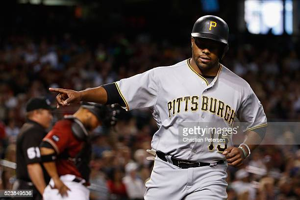 Jason Rogers of the Pittsburgh Pirates reacts after scoring against the Arizona Diamondbacks during the third inning of the MLB game at Chase Field...