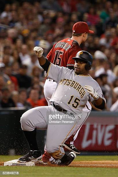 Jason Rogers of the Pittsburgh Pirates slides into third base after hitting a two RBI triple against the Arizona Diamondbacks during the third inning...