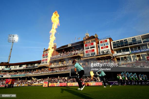 Jason Roy and Aaron Finch of Surrey make their way onto the field to open the batting prior to the NatWest T20 Blast QuarterFinal match between...