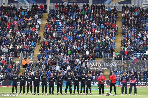 Jason Roy and Alex Hales of England observe a minute's silence for the victims of the London Bridge terrorist attack alongside the umpires and...