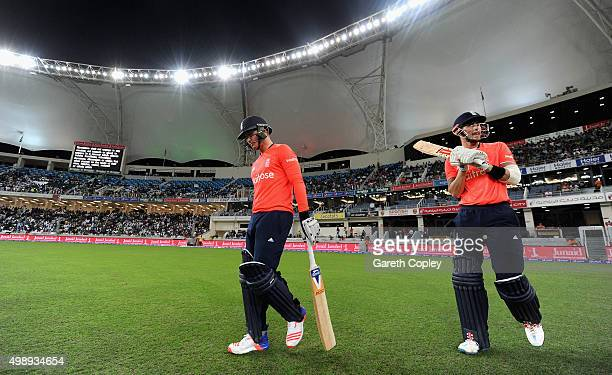 Jason Roy and Alex Hales of England walk out to bat ahead of the 2nd International T20 between Pakistan and England at Dubai Cricket Stadium on...