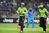 Jason Roy and Jacques Kallis of the Sydney Thunder come from the field as rain delays play during the Big Bash League match between the Adelaide...