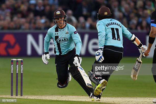 Jason Roy and Kumar Sangakkara of Surrey swerve to avoid each other as they take a quick single during the NatWest T20 Blast between Sussex and...