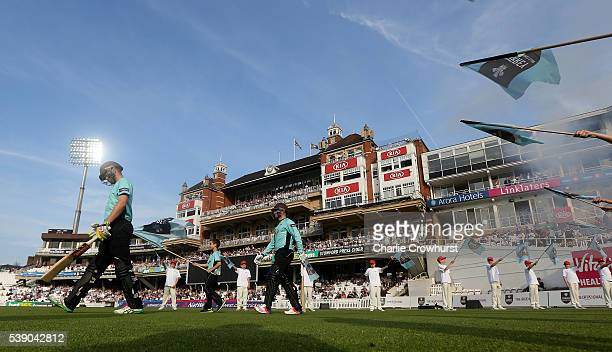 Jason Roy and Rory Burns of Surrey walks out to the field of play during the NatWest T20 Blast match between Surrey and Hampshire at The Kia Oval on...