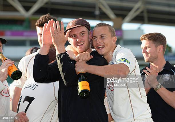 Jason Roy and Tom Curran of Surrey celebrate after winning of the Division 2 LV County Championship during the LV County Championship Division Two...