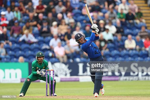 Jason Roy of England hits a straight six off the bowling of Shoaib Malik as wicketkeeper Sarfraz Ahmed looks on during the 5th Royal London OneDay...