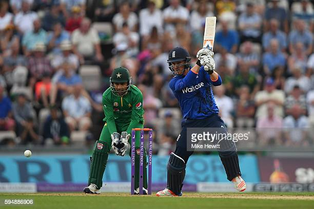 Jason Roy of England hits out as wicketkeeper Sarfraz Ahmed of Pakistan looks on during the 1st One Day International between England and Pakistan at...