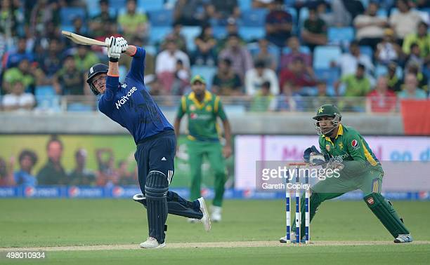 Jason Roy of England hits out for six runs during the 4th One Day International between Pakistan and England at Dubai Cricket Stadium on November 20...