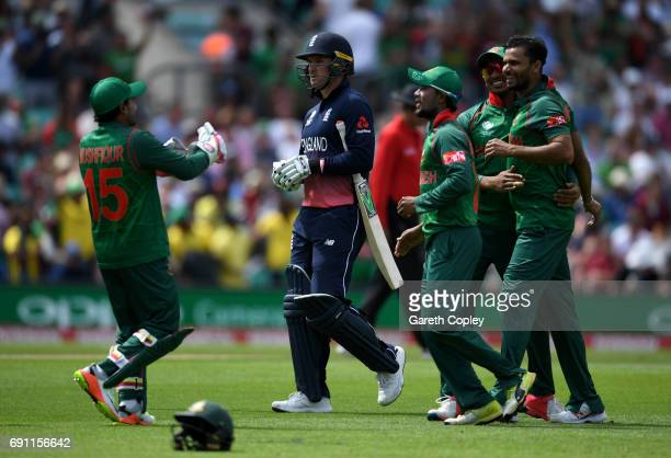 Jason Roy of England leaves the field after being dismissed by Mashrafe Mortaza of Bangladesh during the ICC Champions Trophy group match between...