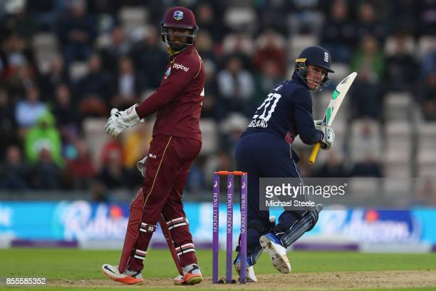 Jason Roy of England plays a delivery behind point as West Indies wicketkeeper Shai Hope looks on during the 5th Royal London One Day International...