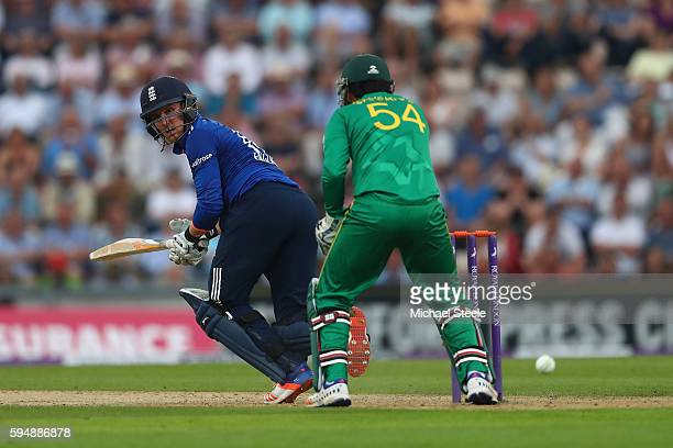 Jason Roy of England plays a shot fine as wicketkeeper Sarfraz Ahmed looks on during the first Royal London One Day match between England and...