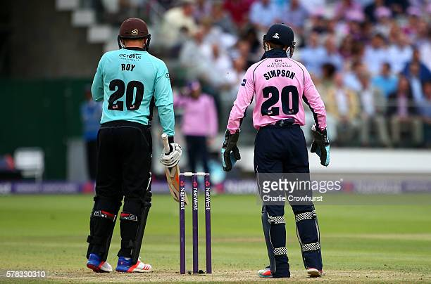 Jason Roy of Surrey and wicket keeper John Simpson of Middlesex both sport number twenty shirts during the NatWest T20 Blast match between Middlesex...
