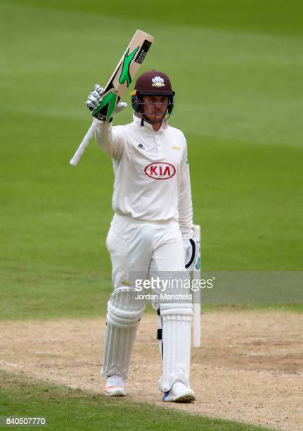 Jason Roy of Surrey celebrates his 50 during day two of the Specsavers County Championship Division One match between Surrey and Middlesex at The Kia...