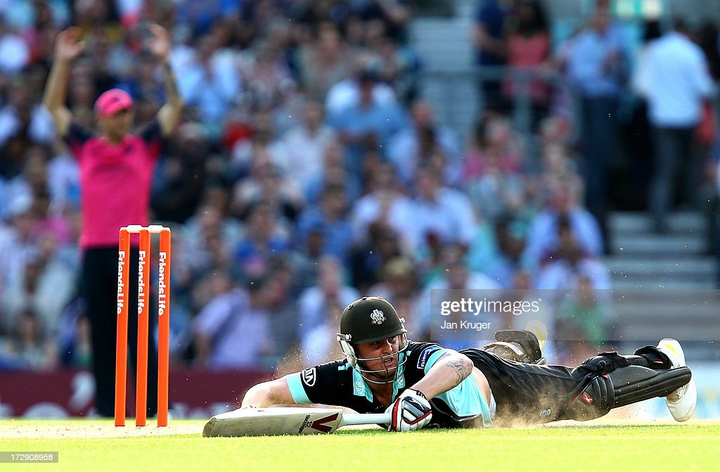 Jason Roy of Surrey dives to make his ground during the Friends Life T20 match between Surrey Lions and Middlesex Panthers at The Kia Oval on July 5, 2013 in London, England.
