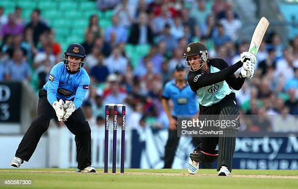 Jason Roy of Surrey hits out while Sussex's Ben Brown looks on during the Natwest T20 Blast match between Surrey and Sussex Sharks at The Kia Oval on...