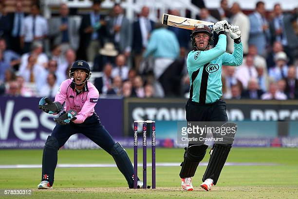 Jason Roy of Surrey hits out while wicket keeper John Simpson of Middlesex looks on during the NatWest T20 Blast match between Middlesex and Surrey...