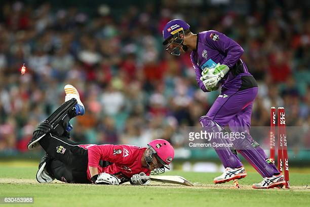 Jason Roy of the Sixers is stumped during the Big Bash League match between the Sydney Sixers and Hobart Hurricanes at Sydney Cricket Ground on...