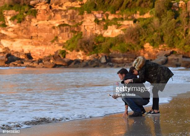 Jason Ruszczyk the brother of Justine Damond and his wife Katarina Ruszczyk are seen during a vigil for his sister at Freshwater Beach on July 19...