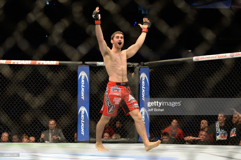 Jason Saggo celebrates after a defeating Josh Shockley by TKO during the UFC 174 event at Rogers Arena on June 14, 2014 in Vancouver, British Columbia, Canada.
