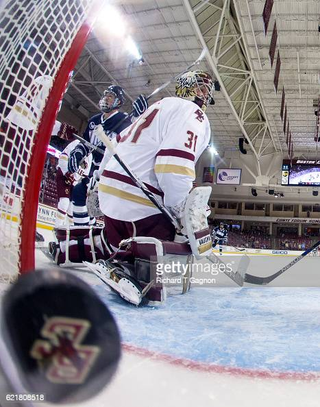 Jason Salvaggio of the New Hampshire Wildcats celebrates after he scored a goal against Joe Woll of the Boston College Eagles during NCAA hockey at...