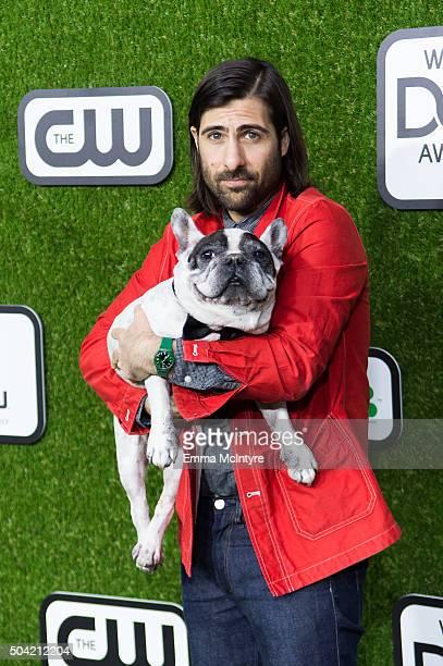 Jason Schwartzman and his dog Arrow arrive at the 2016 World Dog Awards at Barker Hangar on January 9 2016 in Santa Monica California