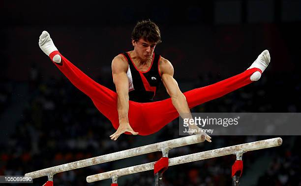 Jason Scott of Canada in action on the Parallel Bars at IG Sports Complex during day five of the Delhi 2010 Commonwealth Games on October 8 2010 in...