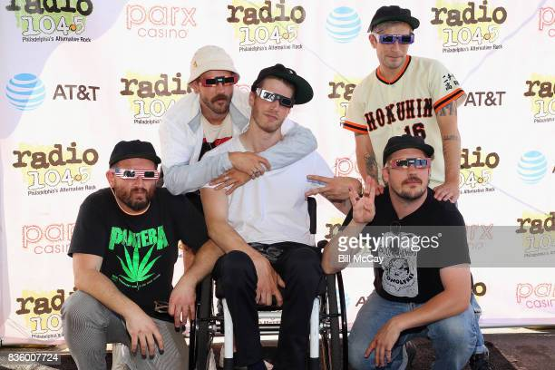 Jason Sechrist John Gourley Eric Howk Kyle O'Quin and Zachary Carothers of the band Portugal The Man pose with Solar Eclipse glasses at the Radio...