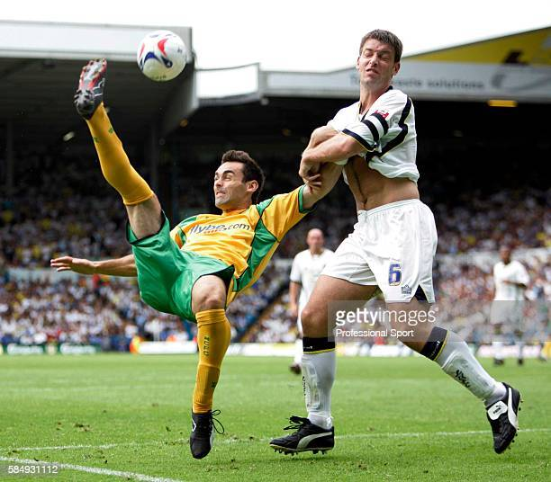 Jason Shackell of Norwich City overhead kicks the ball past Paul Butler of Leeds United during the CocaCola Championship match between Leeds and...