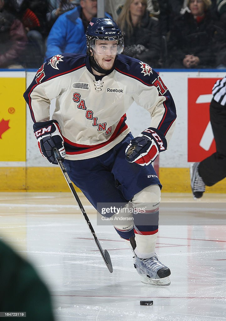 Jason Shaw #71 of the Saginaw Spirit skates with the puck in a first round playoff game against the London Knights on March 24, 2013 at the Budweiser Gardens in London, Ontario, Canada. The Knights defeated the Spirit 3-2 in double overtime to take a 2-0 series lead.