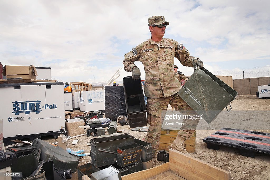 Jason Sherman from Peru, Nebraska sorts through excess equipment and supplies left by departing units as the U.S. draws down manpower in the 13-year-old war on March 22, 2014 near Gardez, Afghanistan. Although some of the material will be put back into the Army supply chain most of it will be destroyed or sold for scrap. In the past year the U.S. Military has been reducing troops and equipment in Afghanistan as it transitions from a role of combatants, fighting alongside Afghan soldiers, to assisting the Afghan National Security Forces in an advisory role. President Obama recently ordered the Pentagon to develop a contingency plan for a complete pullout from Afghanistan by the end of 2014 if Afghanistan President Hamid Karzai or his successor refuses to sign the Bilateral Security Agreement.
