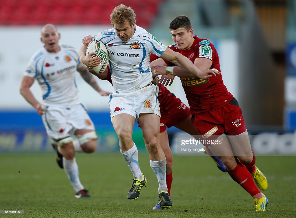 Jason Shoemark of Exeter escapes the tackle of Scott Williams of Scarlets during the Heineken Cup match between Scarlets and Exeter Chiefs at Parc y Scarlets on December 8, 2012 in Llanelli, Wales.