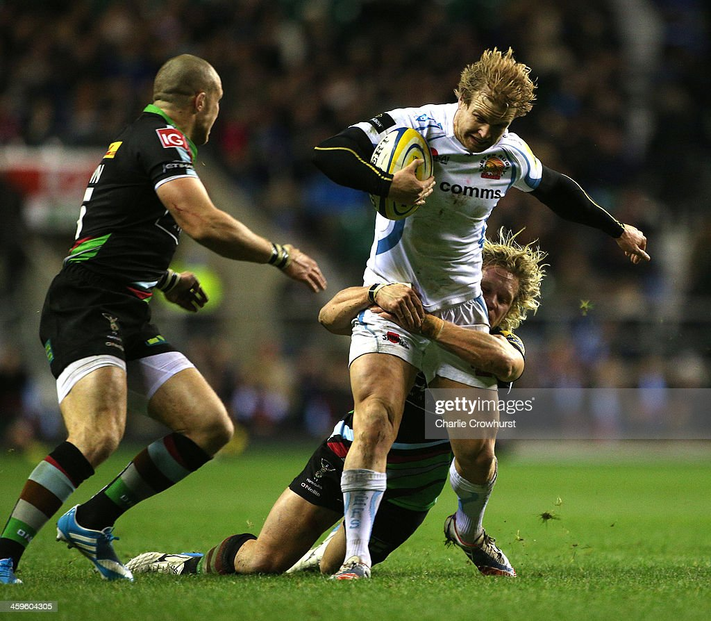 Jason Shoemark of Exeter is held in the tackle by Harlequins Matt Hooper during the Aviva Premiership match between Harlequins and Exeter Chiefs at Twickenham Stadium on December 28, 2013 in London, England.