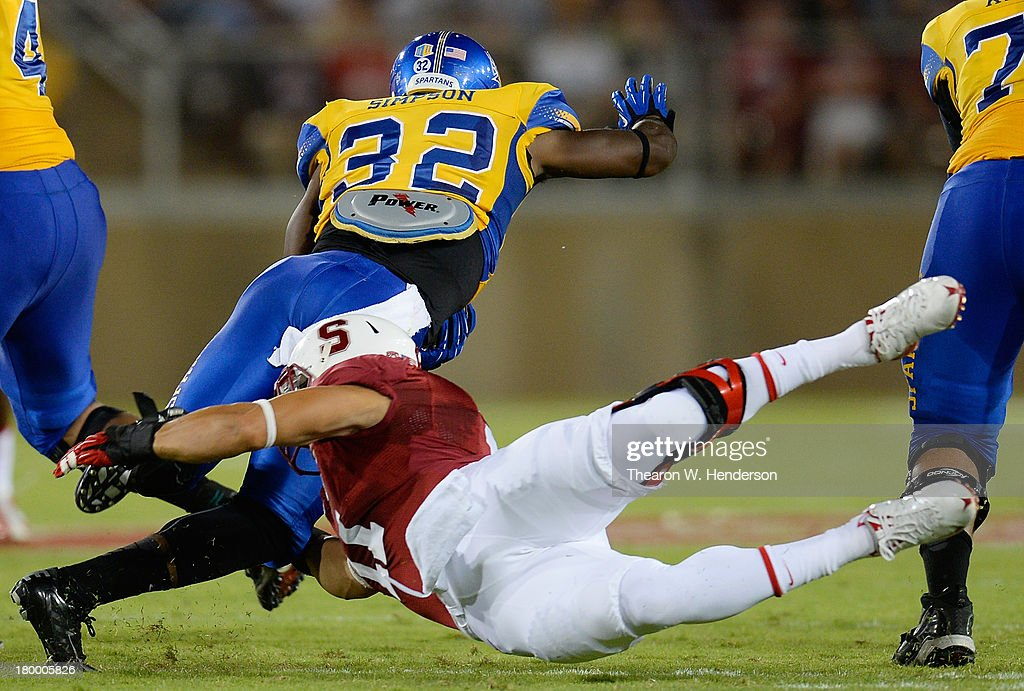 Jason Simpson #32 of the San Jose State Spartans gets tackled by <a gi-track='captionPersonalityLinkClicked' href=/galleries/search?phrase=Shayne+Skov&family=editorial&specificpeople=6362886 ng-click='$event.stopPropagation()'>Shayne Skov</a> #11 of the Stanford Cardinal during the first quarter at Stanford Stadium on September 7, 2013 in Palo Alto, California.