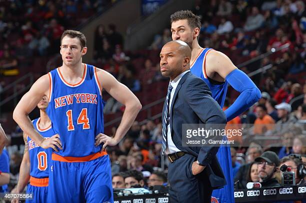 Jason Smith and Head Coach Derek Fisher of the New York Knicks look on against the Philadelphia 76ers at Wells Fargo Center on March 20 2015 in...