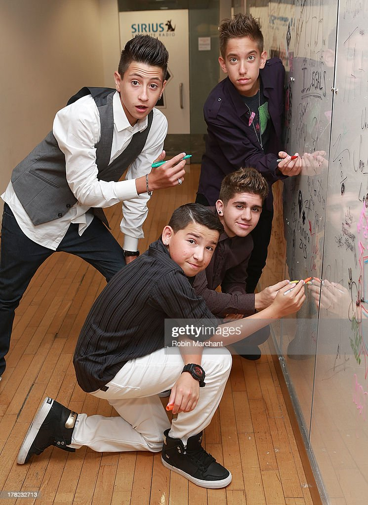 Jason Smith, Madison Alamia, Louis DiPippa and Mikey Fusco of To Be One visit at SiriusXM Studios on August 27, 2013 in New York City.