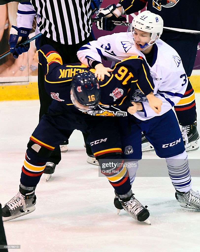 Jason Smith #37 of the Mississauga Steelheads and Ben Hawerchuk #16 of the Barrie Colts fight it out during OHL game action on November 1, 2015 at the Hershey Centre in Mississauga, Ontario, Canada.