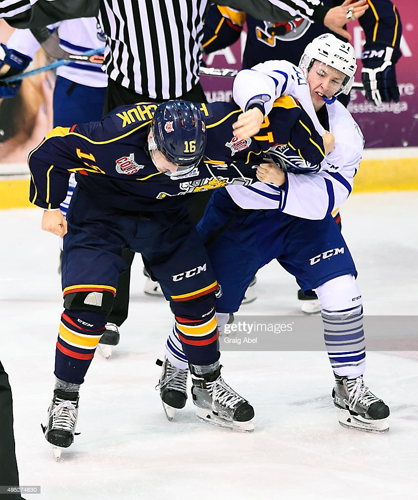 Jason Smith #37 of the Mississauga Steelheads and Ben Hawerchuk #16 the Barrie Colts fight it out during OHL game action on November 1, 2015 at the Hershey Centre in Mississauga, Ontario, Canada.