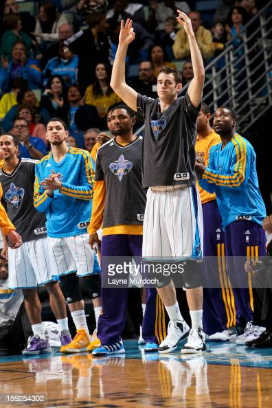 Jason Smith of the New Orleans Hornets celebrates from the bench during a game against the San Antonio Spurs on January 7 2013 at the New Orleans...