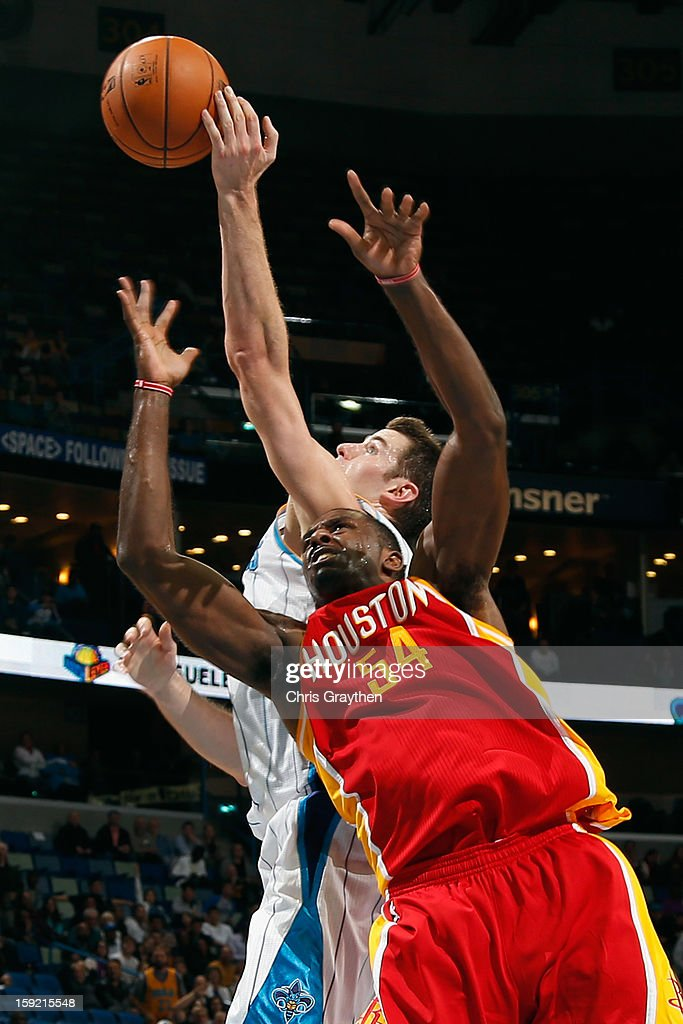 Jason Smith #14 of the New Orleans Hornets fights for a rebound with <a gi-track='captionPersonalityLinkClicked' href=/galleries/search?phrase=Patrick+Patterson&family=editorial&specificpeople=2928099 ng-click='$event.stopPropagation()'>Patrick Patterson</a> #54 of the Houston Rockets at New Orleans Arena on January 9, 2013 in New Orleans, Louisiana. The Hornets defeated the Rockets 88-79.
