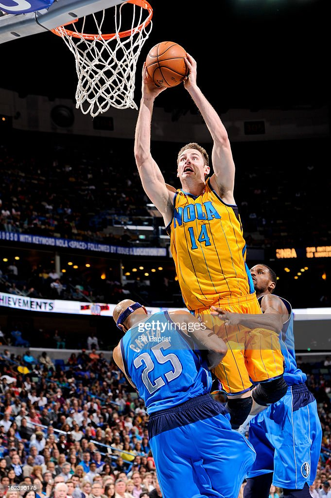 Jason Smith #14 of the New Orleans Hornets rises for a dunk against <a gi-track='captionPersonalityLinkClicked' href=/galleries/search?phrase=Vince+Carter&family=editorial&specificpeople=201488 ng-click='$event.stopPropagation()'>Vince Carter</a> #25 of the Dallas Mavericks on February 22, 2013 at the New Orleans Arena in New Orleans, Louisiana.