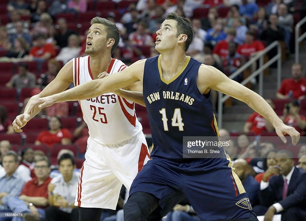 Jason Smith #14 of the New Orleans Pelicans blocks out Chandler Parsons #25 of the Houston Rockets in a preseason NBA game on October 5, 2013 at Toyota Center in Houston, Texas. The Pelicans won 116 to 115.