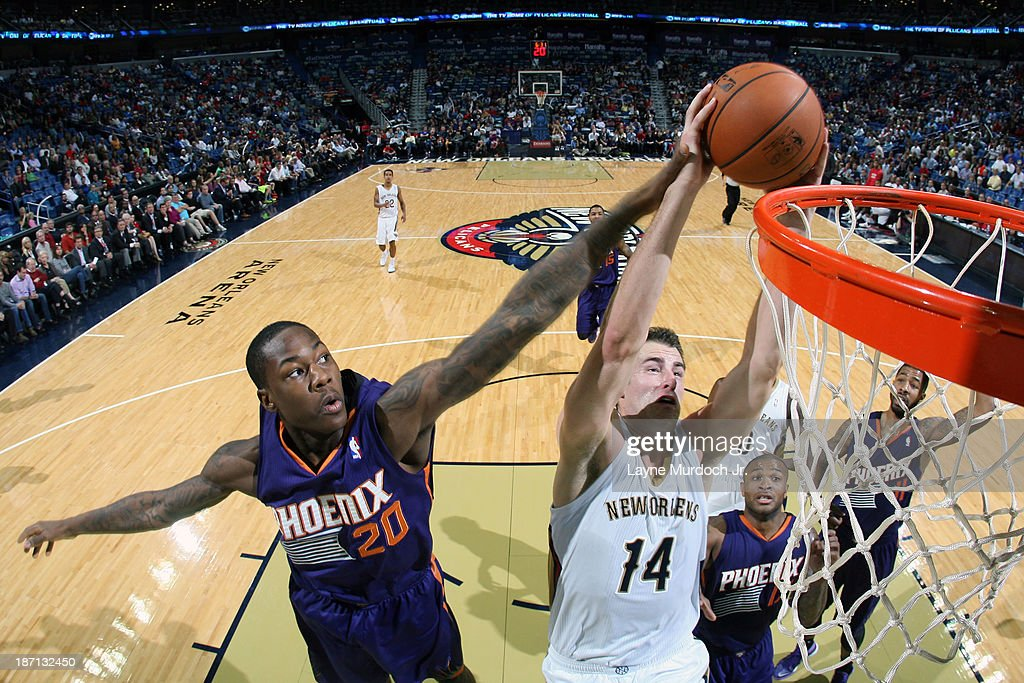 Jason Smith #14 of the New Orleans Pelicans drives to the basket against the Phoenix Suns on November 5, 2013 at the New Orleans Arena in New Orleans, Louisiana.