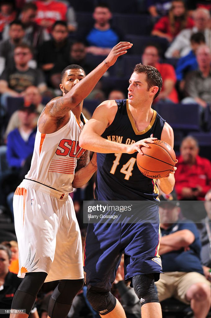 Jason Smith #14 of the New Orleans Pelicans is guarded by Marcus Morris #15 of the Phoenix Suns on November 10, 2013 at U.S. Airways Center in Phoenix, Arizona.