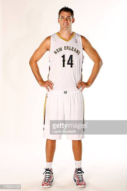 Jason Smith of the New Orleans Pelicans poses with the team's new home uniform on August 1 2013 at the New Orleans Pelicans practice facility in...
