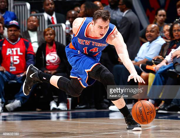 Jason Smith of the New York Knicks chases down a loose ball against the Atlanta Hawks at Philips Arena on April 13 2015 in Atlanta Georgia NOTE TO...